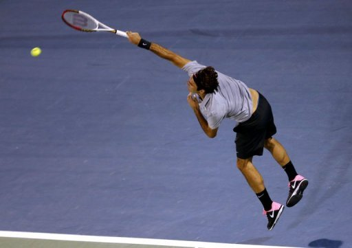 Roger Federer serves to Malek Jaziri in Dubai on February 25, 2013