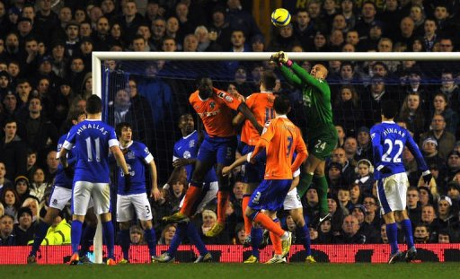 Everton's goalkeeper Tim Howard (2ndR) clears the ball at Goodison Park in Liverpool, February 26, 2013