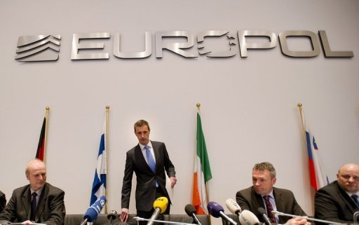 Europol's chief Rob Wainwright (2nd left) arrives for a press conference in The Hague today. European police warned Monday that the integrity of football was at stake, as they revealed they had smashed a criminal network fixing hundreds of matches, including in the Champions League and World Cup qualifiers.