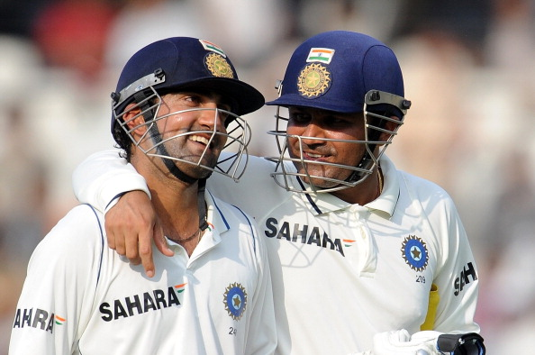 Indian cricketer Virendra Sehwag (R) sha