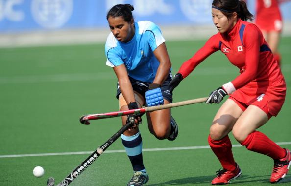 Ritu Rani (L) of India vies for the ball