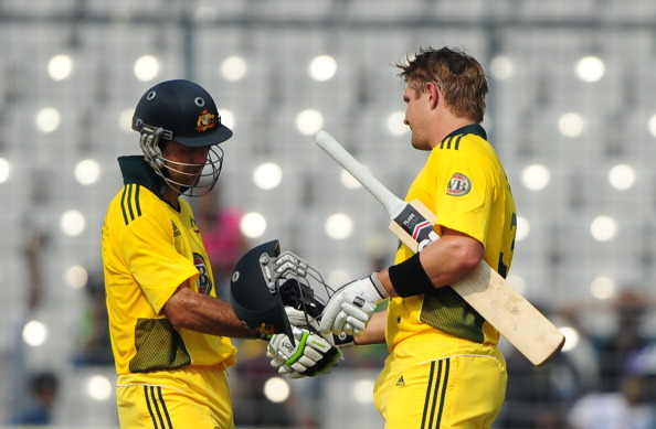 Australian batsman Shane Watson (R) shak