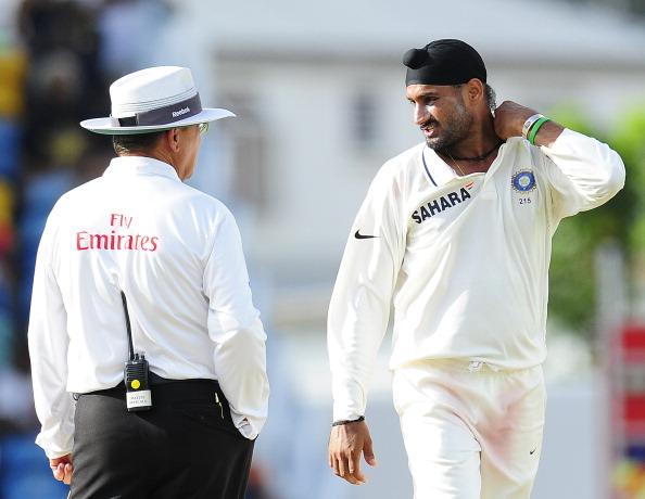 Indian bowler Harbhajan Singh talks with