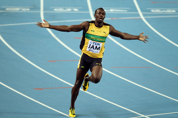 Usain Bolt of Jamaica celebrates victory and a new world record in the men's 4x100 metres relay final during day nine of 13th IAAF World Athletics Championships at Daegu Stadium on September 4, 2011 in Daegu, South Korea.  (Photo by Andy Lyons/Getty Images)