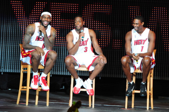 (L-R) LeBron James, Dwyane Wade and Chris Bosh attend HEAT Summer of 2010 Welcome Event at AmericanAirlines Arena on July 9, 2010 in Miami, Florida.
