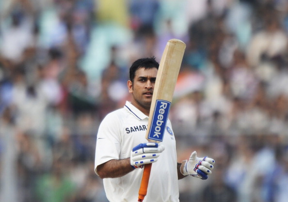 Indian cricket captain Mahendra Singh Dhoni raises his bat after scoring his century (100 runs) during the second day of the second Test match between Indian and West Indies at The Eden Gardens in Kolkata on November 15, 2011. The West Indies were struggling at 34-2 in their first innings at stumps in reply to India's 631-7 declared on the second day of the second Test. AFP PHOTO/Dibyangshu SARKAR (Photo credit should read DIBYANGSHU SARKAR/AFP/Getty Images)