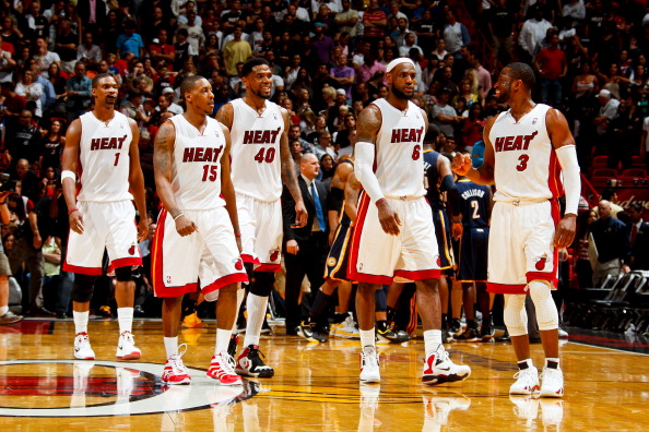 The starting 5: Miami Heat players Chris Bosh #1, Mario Chalmers #15, Udonis Haslem #40, LeBron James #6, and Dwyane Wade #3. (Getty Images)