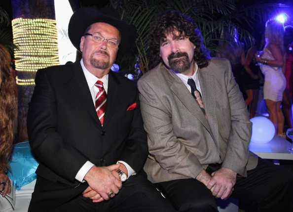 Jim Ross (L), with WWE Hall of Fame Inductee Mick Foley