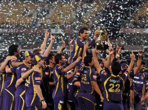 Kolkata Knight Riders teammates celebrate their victory after they won the DLF IPL Twenty20 Champions Trophy in a final match against Chennai Super Kings at the M.A. Chidambaram Stadium in Chennai on May 27, 2012. RESTRICTED TO EDITORIAL USE. MOBILE USE WITHIN NEWS PACKAGE. AFP PHOTO/Manjunath KIRAN        (Photo credit should read Manjunath Kiran/AFP/GettyImages)