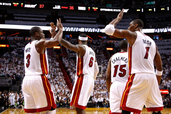 MIAMI, FL - JUNE 17:  (L-R) Dwyane Wade #3, LeBron James #6 and Chris Bosh #1 of the Miami Heat celebrate a play in the first half against the Oklahoma City Thunder in Game Three of the 2012 NBA Finals on June 17, 2012 at American Airlines Arena in Miami, Florida.  NOTE TO USER: User expressly acknowledges and agrees that, by downloading and or using this photograph, User is consenting to the terms and conditions of the Getty Images License Agreement.  (Photo by Mike Ehrmann/Getty Images)