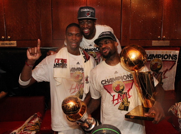 MIAMI, FL - JUNE 21:  Chris Bosh #1, Dwyane Wade #3, and LeBron James #6 of the Miami Heat pose for a photo in the locker room after defeating the Oklahoma City Thunder during Game Five of the 2012 NBA Finals to win the NBA Championship at American Airlines Arena on June 21, 2012 in Miami, Florida. NOTE TO USER: User expressly acknowledges and agrees that, by downloading and or using this Photograph, user is consenting to the terms and conditions of the Getty Images License Agreement. Mandatory Copyright Notice: Copyright 2012 NBAE (Photo by Nathaniel S. Butler/NBAE via Getty Images)