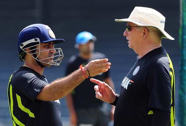 Indian cricket coach Duncan Fletcher (R) gives instructions to cricketer Virender Sehwag during a practice session at the R. Premadasa Cricket Stadium in Colombo on July 26, 2012.  Sri Lanka thrashed India by nine wickets in the second one-day international in Hambantota to level the five-match series 1-1, with the third one-day international to be played in Colombo on July 28. AFP PHOTO/ LAKRUWAN WANNIARACHCHI        (Photo credit should read LAKRUWAN WANNIARACHCHI/AFP/GettyImages)