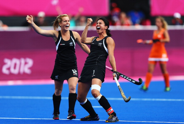 LONDON, ENGLAND - AUGUST 08:  Kayla Sharland of  New Zealand celebrates scoring the first goal for New Zealand with her team-mate Ella Gunson during the Women's Hockey semi-final match between New Zealand and the Netherlands on Day 12 of the London 2012 Olympic Games at Riverbank Arena Hockey Centre on August 8, 2012 in London, England.  (Photo by Paul Gilham/Getty Images)