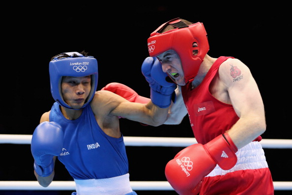 LONDON, ENGLAND - AUGUST 08:  Paddy Barnes (R) of Ireland in action against Devendro Singh Laishram of India during the Men's Light Fly (49kg) Boxing quarterfinals on Day 12 of the London 2012 Olympic Games at ExCeL on August 8, 2012 in London, England.