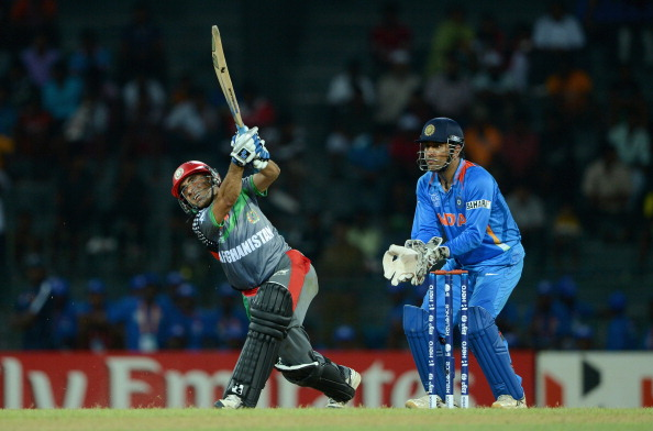 MS Dhoni keeps the wickets in a T20 match against Afghanistan.