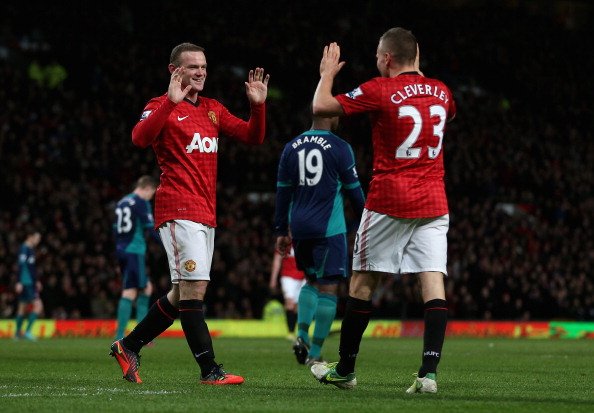 MANCHESTER, ENGLAND - DECEMBER 15:  Wayne Rooney of Manchester United is congratulated by Tom Cleverley of Manchester United after he scored the third goal during the Barclays Premier League match between Manchester United and Sunderland at Old Trafford on December 15, 2012 in Manchester, England.  (Photo by Julian Finney/Getty Images)