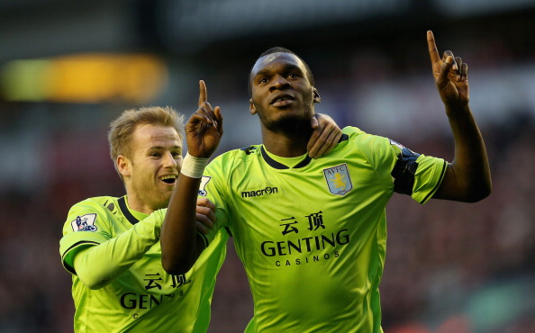 Christian Benteke of Aston Villa celebrates after scoring the first goal with team mate Barry Bannan during the Barclays Premier League match between Liverpool and Aston Villa at Anfield on  December 15, 2012 in Liverpool, England.  (Photo by Clive Brunskill/Getty Images)