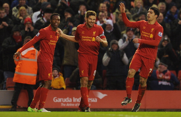 Steven Gerrard of Liverpool celebrates his goal with team-mates Daniel Sturridge and Luis Suarez during the Barclays Premier League match between Liverpool and Norwich City at Anfield on January 19, 2013 in Liverpool, England.  (Photo by Andrew Powell/Liverpool FC via Getty Images)