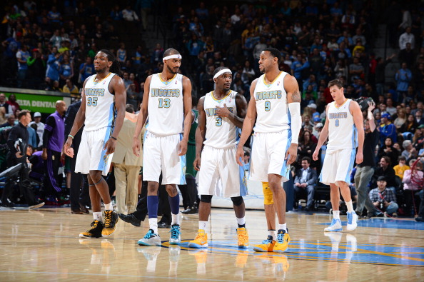 Kenneth Faried 35, Corey Brewer #13 , Ty Lawson #3 and Andre Iguodala #9 of the Denver Nuggets.