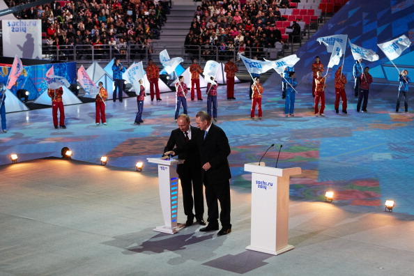 Russian president Vladimir Putin and former skier Jean-Claude Killy hit the countdown button during the 'Sochi 2014 - One Year To Go' ceremony at Bolshoi Ice Dome on February 7, 2013 in Sochi, Russia. (Photo by Oleg Nikishin/Getty Images