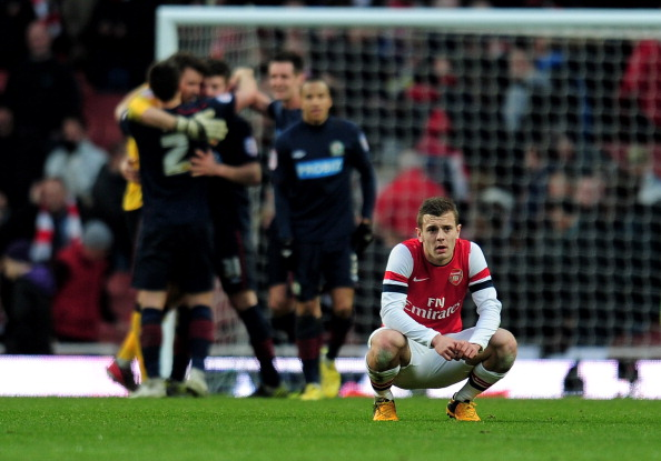 Jack Wilshere cuts a lone figure after Arsenal's defeat to Blackburn. (Getty Images).