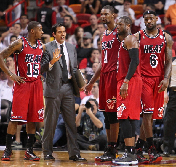 Miami Heat head coach Erik Spoelstra, gives instructions to Mario Chalmers,(15), Chris Bosh,(1), Dwyane Wade,(3), and LeBron James,(6) during overtime against the Sacramento Kings at the American Airlines Arena in Miami, Florida, Tuesday, February 26, 2013. The Heat defeated the Kings in double overtime, 141-129. (David Santiago/El Nuevo Herald/MCT via Getty Images)