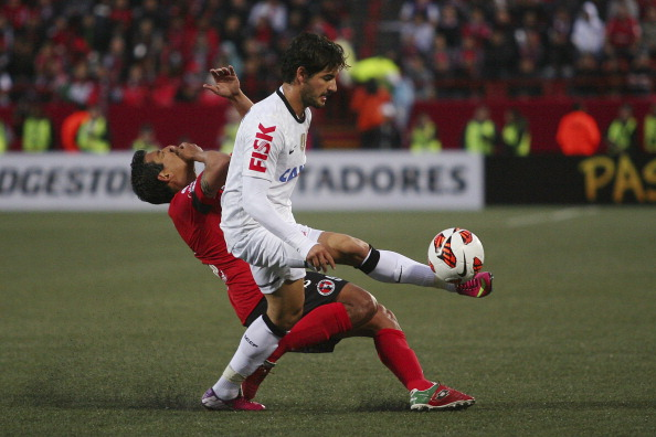 Alfredo Moreno (L) of Tijuana struggles for the ball with Alexandre Pato (R) of Corinthians during a match between Tijuana and Corinthians as part of Copa Bridgestone Libertadores 2013 at Caliente Stadium on March 06, 2013 in Tijuana, Mexico (Photo by Fausto Vargas/Jam Media/LatinContent/Getty Images)