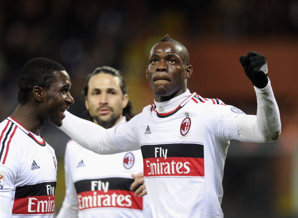 Mario Balotelli of AC Milan (R) celebrates scoring the second goal during the Serie A match between Genoa CFC and AC Milan at Stadio Luigi Ferraris on March 8, 2013 in Genoa, Italy.  (Photo by Claudio Villa/Getty Images)