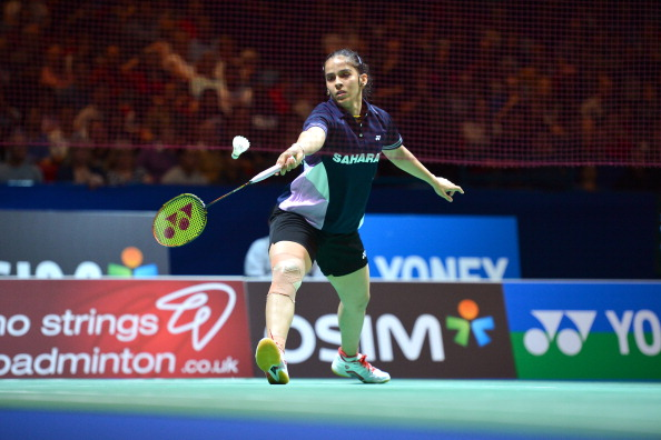 India's Saina Nehwal returns to Thailand's Intanon Ratchanok during their All England Open Badminton Championships women's singles semi-final match in Birmingham, central England, on March 9, 2013. AFP PHOTO/BEN STANSALL        (Photo credit should read BEN STANSALL,BEN STANSALL/AFP/Getty Images)