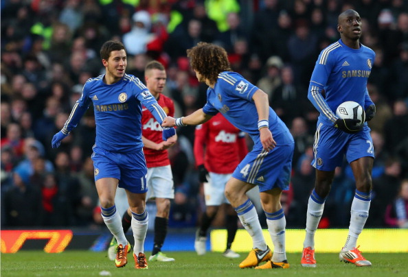 MANCHESTER, ENGLAND - MARCH 10:  Eden Hazard (l) of Chelsea is congratulated by team-mate David Luiz after scoring his team's first goal during the FA Cup sponsored by Budweiser Sixth Round match between Manchester United and Chelsea at Old Trafford on March 10, 2013 in Manchester, England.  (Photo by Alex Livesey/Getty Images)