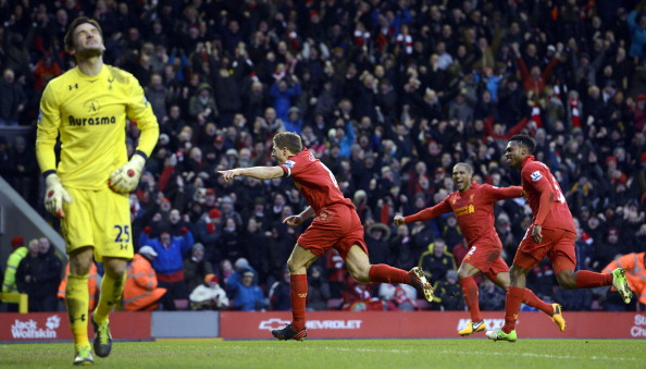 Liverpool's English midfielder Steven Gerrard (C) celebrates scoring a penalty past Tottenham Hotspur's French goalkeeper Hugo Lloris (L) during the English Premier League football match between Liverpool and Tottenham Hotspur at Anfield stadium in Liverpool, northwest England, on March 10, 2013.