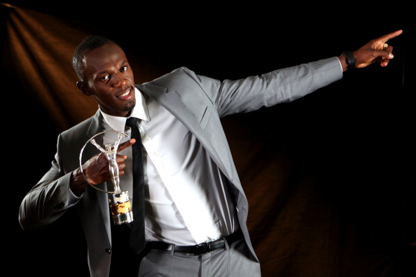 Sprinter Usain Bolt of Jamaica poses with the award for Laureus World Sportsman of the Year.