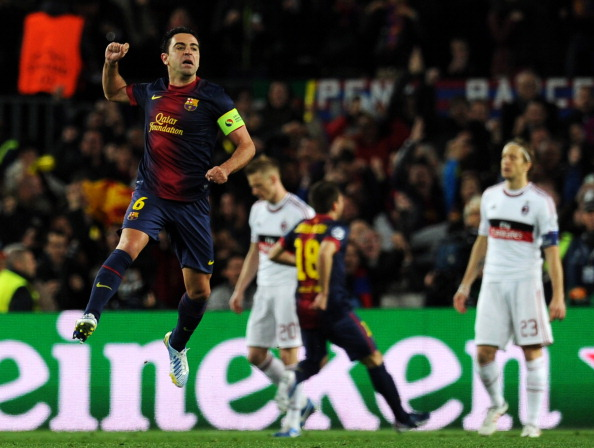 Barcelona's midfielder Xavi Hernandez celebrates his team's first score during the UEFA Champions League round of 16 second leg football match FC Barcelona against AC Milan at Camp Nou stadium in Barcelona on March 12, 2013.