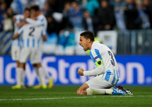 Weligton (R) of Malaga CF celebrates at the end of the UEFA Champions League Round of 16 second leg match between Malaga CF and FC Porto at La Rosaleda Stadium on March 13, 2013 in Malaga, Spain.