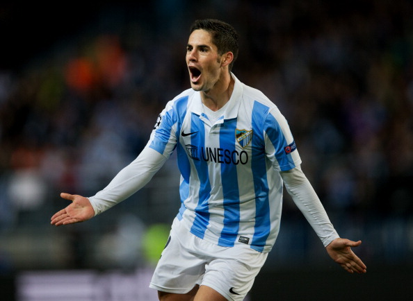 Isco of Malaga CF celebrates scoring his sides opening goal during the UEFA Champions League Round of 16 second leg match between Malaga CF and FC Porto at La Rosaleda Stadium on March 13, 2013 in Malaga, Spain.