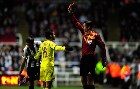 NEWCASTLE UPON TYNE, ENGLAND - MARCH 14:  FC Anji player Mehdi Carcela-Gonzalez is sent off by referee Deniz Aytekin during the UEFA Europa League Round of 16 second leg match between Newcastle United FC and FC Anji Makhachkala at St James' Park on March 14, 2013 in Newcastle upon Tyne, England.  (Photo by Stu Forster/Getty Images)