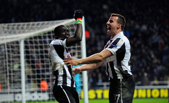 NEWCASTLE UPON TYNE, ENGLAND - MARCH 14:  Newcastle players Papiss Cisse (l) and Steven Taylor celebrate the winning goal during the UEFA Europa League Round of 16 second leg match between Newcastle United FC and FC Anji Makhachkala at St James' Park on March 14, 2013 in Newcastle upon Tyne, England.  (Photo by Stu Forster/Getty Images)