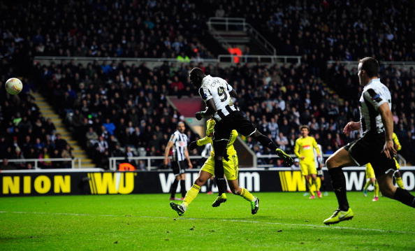 Newcastle player Papiss Cisse (c) heads the winning goal during the UEFA Europa League Round of 16 second leg match between Newcastle United FC and FC Anji Makhachkala at St James' Park on March 14, 2013 in Newcastle upon Tyne, England.  (Photo by Stu Forster/Getty Images)