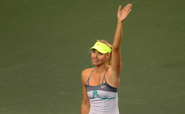 Maria Sharapova of Russia acknowledges the crowd after defeating compatriot Maria Kirilenko on March 15, 2013 in Indian Wells, California, in their semirfinal match at the BNP Paribas Open. AFP PHOTO/Frederic J. BROWN        (Photo credit should read FREDERIC J. BROWN/AFP/Getty Images)