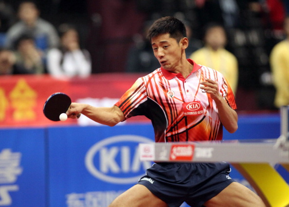 Olympic Champion Zhang Jike of China returns a shot against Dimitrij Ovtcharov of Germany during the Asia-Europe all-stars series table tennis in Qingdao, northeast China's Shandong province on March 17, 2013.  Zhang beat Ovtcharov 11:8, 11:2, 11:9 as the Asian side won the first leg of the the 2013 Asia-Europe All Stars Series 7:3 on aggregate, after being 2:3 down.           AFP PHOTO        (Photo credit should read STR/AFP/Getty Images)