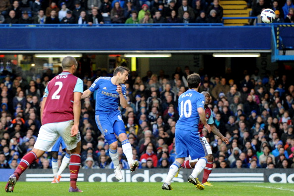 Chelsea's English midfielder Frank Lampard (C) scores the opening goal against West Ham United during the English Premier League football match between Chelsea and West Ham United at Stamford Bridge in London on March 17, 2013.  AFP PHOTO / OLLY GREENWOOD RESTRICTED TO EDITORIAL USE. No use with unauthorized audio, video, data, fixture lists, club/league logos or ?live? services. Online in-match use limited to 45 images, no video emulation. No use in betting, games or single club/league/player publications.        (Photo credit should read OLLY GREENWOOD/AFP/Getty Images)
