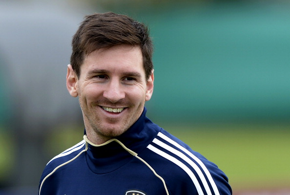 Argentina's forward Lionel Messi smiles during a training session in Ezeiza, Buenos Aires on March 19, 2013 ahead of the Brazil 2014 FIFA World Cup South American qualifier football match against Venezuela on March 26. AFP PHOTO / Juan Mabromata        (Photo credit should read JUAN MABROMATA/AFP/Getty Images)