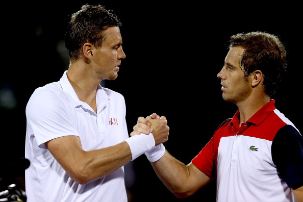 Tomas Berdych of Czech Republic congratulates Richard Gasquet of France after their match during the Sony Open at Crandon Park Tennis Center on March 27, 2013 in Key Biscayne, Florida.  (Photo by Matthew Stockman/Getty Images)