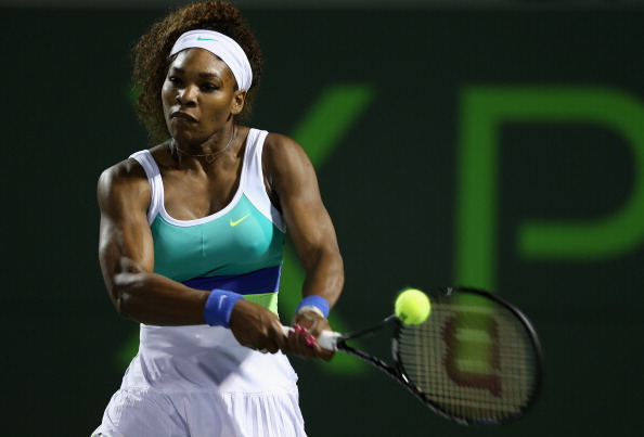 Serena Williams plays a backhand against Agnieszka Radwanska of Poland during their semi final match at the Sony Open at Crandon Park Tennis Center on March 28, 2013 in Key Biscayne, Florida.  (Photo by Clive Brunskill/Getty Images)