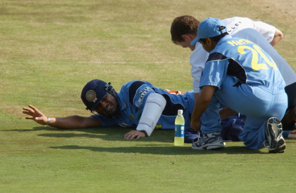 Sachin Tendulkar of India receives medical attention