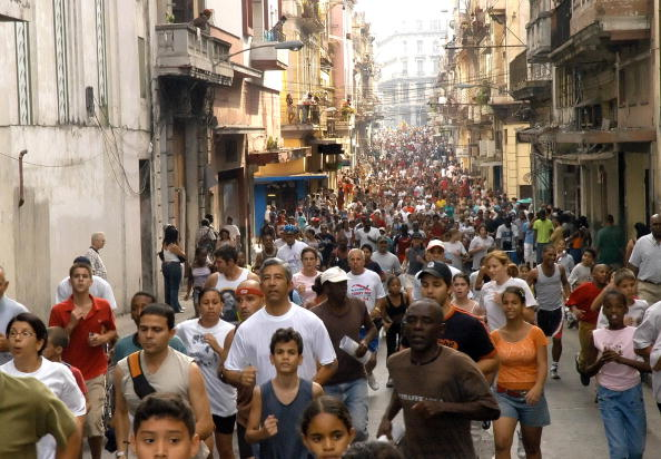 LA HABANA, CUBA:  Thousands of people take part in the Terry Fox's Marathon of Hope 17 March 2006 in Havana, on the year of the 25th anniversary of his death. The marathon is ran every year in more that 50 countries in honour of Fox, a 18-year-old Canadian, who after having one leg amputated due to caner, covered 5565 km in 143 days to increase public awareness of the illness. The 9th edition of the race in Cuba is aimed at raising money for the fight against breast and cervical cancer. Fox died at the age of 23 in June 1981.   AFP PHOTO/Adalberto ROQUE   (Photo credit should read ADALBERTO ROQUE/AFP/Getty Images)