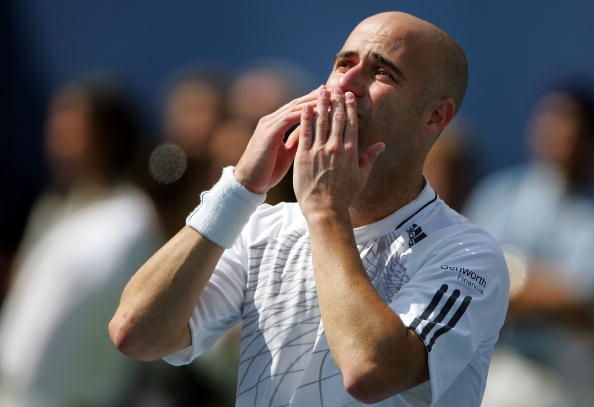 Andre Agassi blows kisses to the crowd after being defeated by Benjamin Becker of Germany in four sets during the U.S. Open at the USTA Billie Jean King National Tennis Center in Flushing Meadows Corona Park on September 3, 2006 in the Flushing neighborhood of the Queens borough of New York City.  (Photo by Ezra Shaw/Getty Images)Andre Agassi blows kisses to the crowd after being defeated by Benjamin Becker of Germany in four sets during the U.S. Open at the USTA Billie Jean King National Tennis Center in Flushing Meadows Corona Park on September 3, 2006 in the Flushing neighborhood of the Queens borough of New York City.  (Photo by Ezra Shaw/Getty Images)