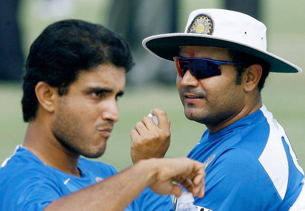 Indian cricketers Sourav Ganguly (L) and