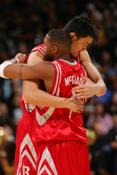 OAKLAND, CA - NOVEMBER 29: Tracy McGrady #1 and Yao Ming #11 of the Houston Rockets embrace before a game against the Golden State Warriors November 29, 2007 at Oracle Arena in Oakland, California. NOTE TO USER: User expressly acknowledges and agrees that, by downloading and or using this photograph, user is consenting to the terms and conditions of Getty Images License Agreement. Mandatory Copyright Notice: Copyright 2007 NBAE  (Photo by Rocky Widner/NBAE via Getty Images)