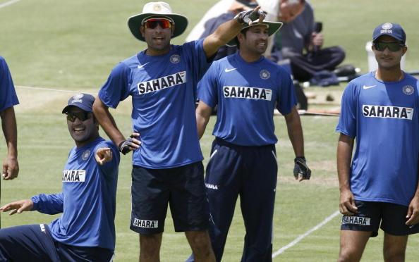 India's Mahendra Singh Dhoni (L) and V.